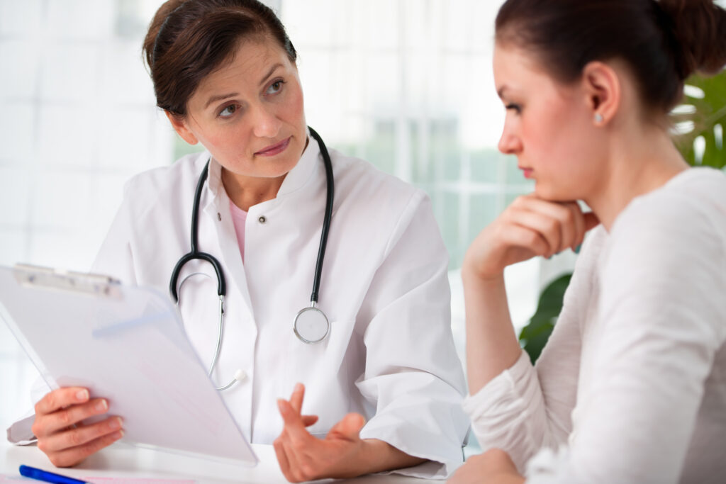 Doctor explaining options to her female patient